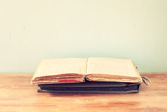 Old book over wooden shelf Royalty Free Stock Images