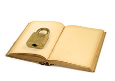 Old book with padlock Royalty Free Stock Images