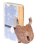 Old book with a padlock inserted through the pages Royalty Free Stock Image
