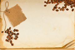 Old book page, coffee and cardboard Royalty Free Stock Image