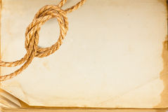 Old book page and hemp rope. With space for your text royalty free stock images