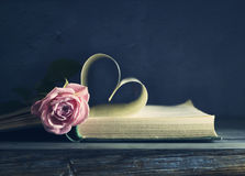 Old Book Page With A Heart-shaped Valentine`s Day And A Pink Rose Royalty Free Stock Photo
