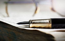 Old book and pen. Photo of a Old book and pen, close up royalty free stock photo