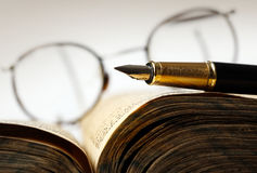 Old book and pen. Photo of a Old book and pen, close up stock images