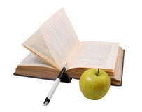 The old book with a pen and an apple Royalty Free Stock Photo