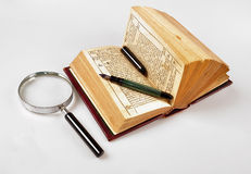 Old book,pen and magnifie Stock Photography