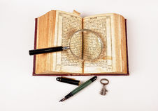 Old book and pen Stock Photography