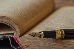 Old book pen Royalty Free Stock Photography