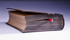 Old book with pencil Royalty Free Stock Photography