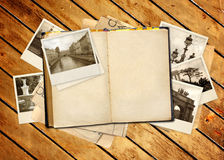 Old book and photos Royalty Free Stock Photography