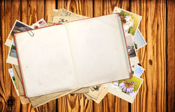 Old book and photos Stock Photos