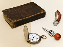 Old book and pocket watch Royalty Free Stock Images