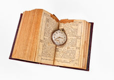 Old book and pocket watch Royalty Free Stock Photography