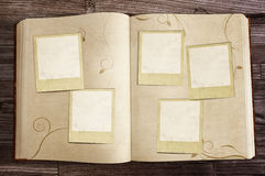 Old Book with Polaroids Stock Photos