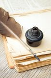 Old book, quill and black ink Royalty Free Stock Photography