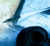 Old book with quill and inkpot Stock Photography