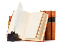 Old book with quill pen Stock Photography
