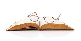 Old book with reading glasses Royalty Free Stock Photography
