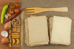 Old book of recipes for pasta. Recipe book. Homework pasta. The diet, according to cookbook. Vegetables and pasta. royalty free stock photography