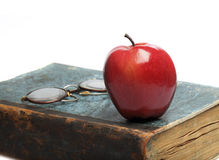 Old Book with red Apple Stock Photos