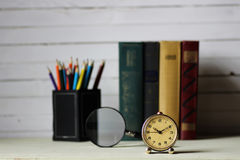 Old book retro watch. Old book with retro watch on a table Stock Photos