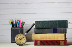 Old book retro watch. Old book with retro watch on a table Stock Image