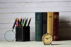 Old book retro watch. Vintage objects in the composition of the concept of nostalgia of the past Stock Photography