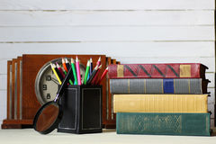 Old book retro watch. Old book and retro watch on white wooden table Stock Photography