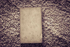 Old book on rustic carpet texture Stock Photo