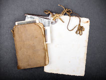 Old book, rusty key and empty photograph Royalty Free Stock Image
