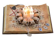 Magic book with candles and medallion Stock Photo