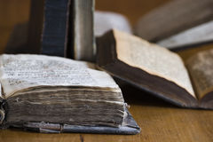 Old book scattered. Some old, antique books scattered on a table stock images