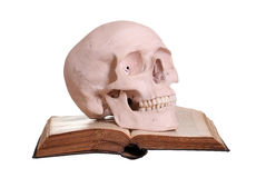 Old book with skull Royalty Free Stock Photos