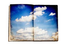 Old book with sky illustration Royalty Free Stock Photo