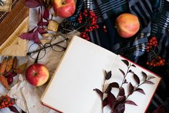 Old book,smart phone , autumn leaves on wooden background. Concept autumn. Top view. copy space. Warm vintage tone. Warm Royalty Free Stock Photos