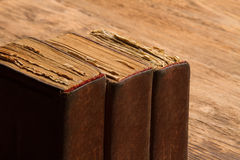 Old book stack, brown blank spine yellow pages, macro of weather Royalty Free Stock Photography