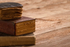 Old book stack, brown pages blank spine, macro of aged library h Stock Photos