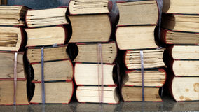 Old book stack Stock Photos