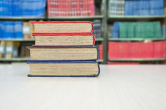 Old book stack on desk in library Royalty Free Stock Photo