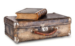 Old book on a suitcase Royalty Free Stock Photo