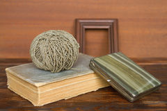 Old book, thread and cigarette case Stock Image