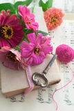 Old book with vintage key and pink flowers zinnia Stock Photography