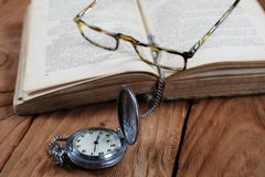 Old book vintage watches glasses Royalty Free Stock Photography