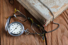 Old book vintage watches glasses Royalty Free Stock Photo