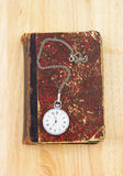 Old book and watch Royalty Free Stock Photo