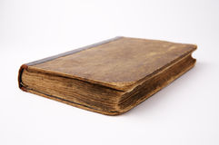 Old book on white background. With shallow focus Royalty Free Stock Photos
