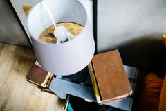 Old book and white lamp on bedside table royalty free stock photos