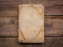 Old book. On wood background Royalty Free Stock Images
