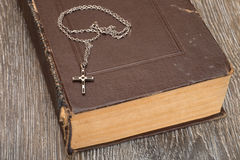Old book on wood background. Royalty Free Stock Image