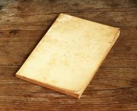 Old book on wooden background Royalty Free Stock Images
